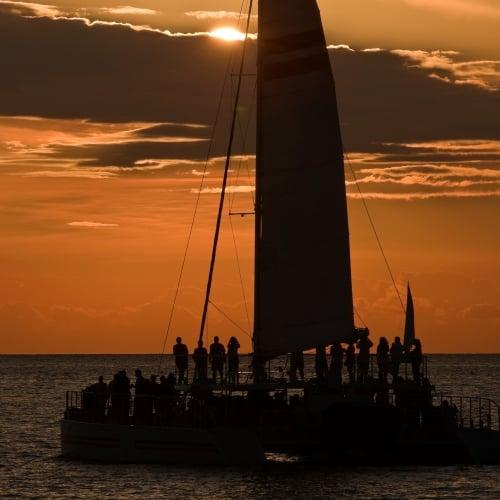 Catamaran sailing at Sunset.