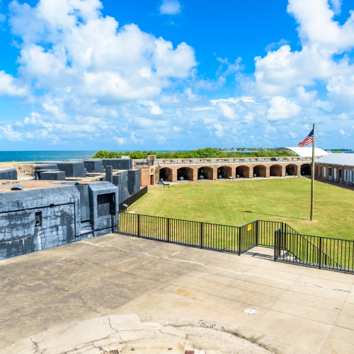 The grounds of Fort Zachary Taylor State Park with the Atlantic Ocean in the background.