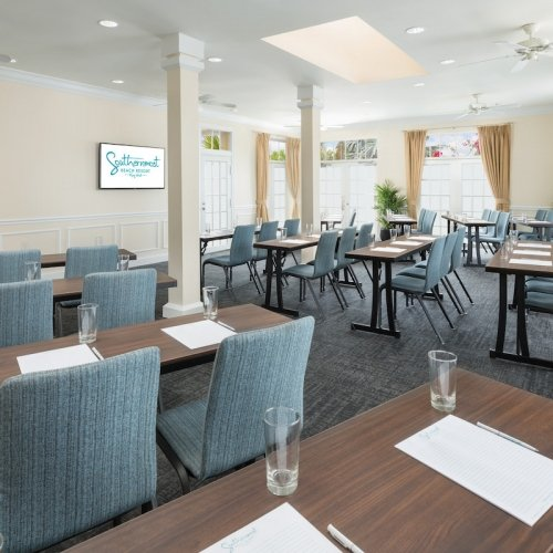 Tables and chairs set up classroom style in the natural light-filled South Beach Room at Southernmost Beach Resort.