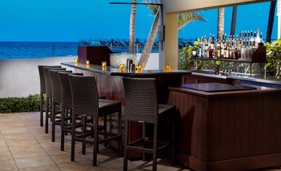 Rattan stools sit in front of the Sand Bar at Southernmost Beach Resort.