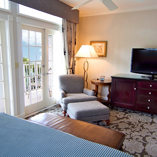 Sitting area and TV from the bed in the Ocean View Room at Southernmost Beach Resort.