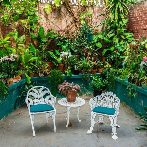 Brick walls and tropical plants at West Martello Tower Key West Garden Club