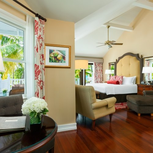 Seating area, including bed and desk at the balcony door in the La Mer Dewey