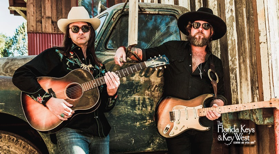 The Allman Betts Band & JD Simo posing with their guitars, sunglasses and cowboy hats.