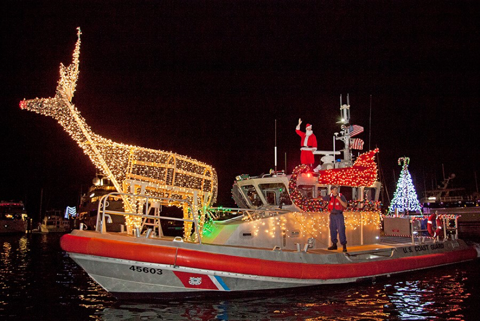 Participating boat in the Schooner Wharf Bar Lighted Boat Parade showing off their large large deer, sled and tree light structures.