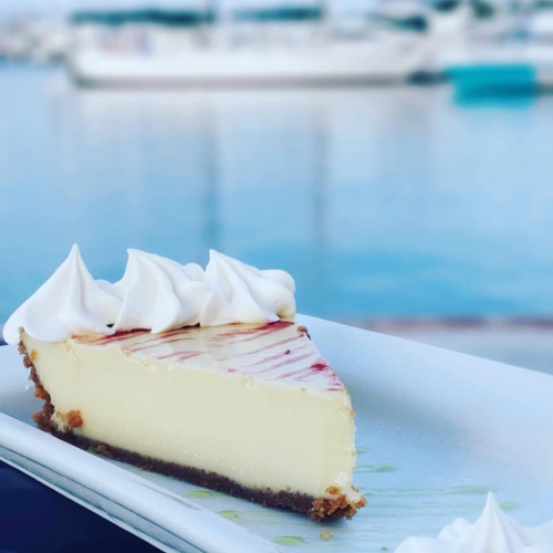 Key Lime Pie on a plate in front of a harbour