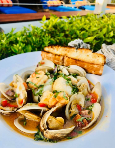 Sautéed shrimp, scallops clams chorizo and red peppers in a garlic wine broth with a side of grilled focaccia bread - one of the specials at Southernmost Beach Cafe