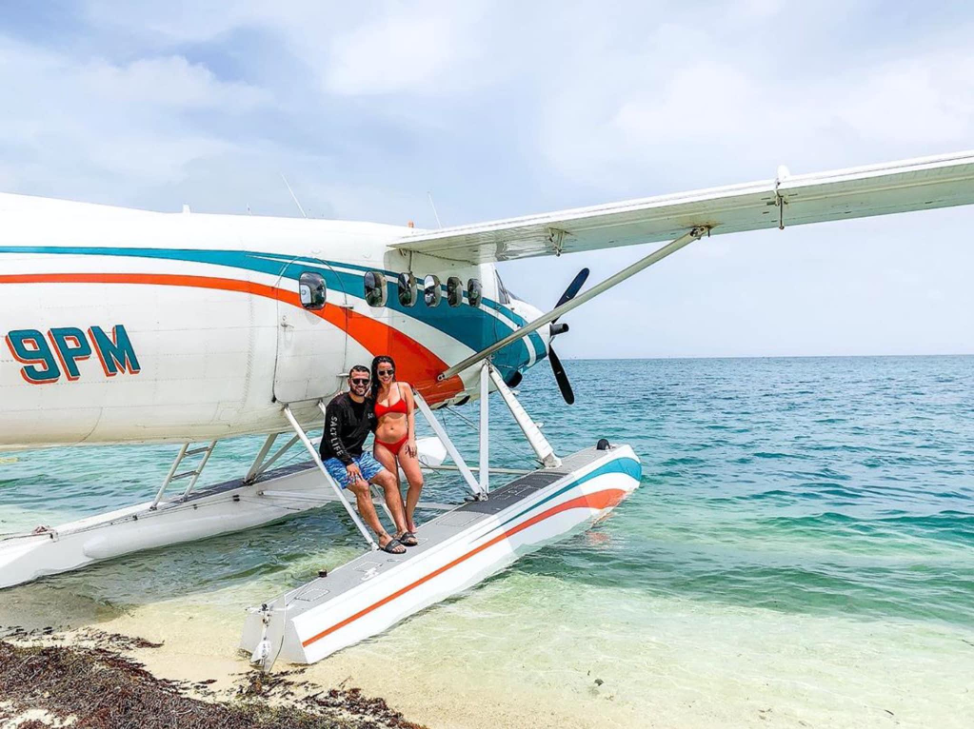 A couple learning against the Key West Seaplane