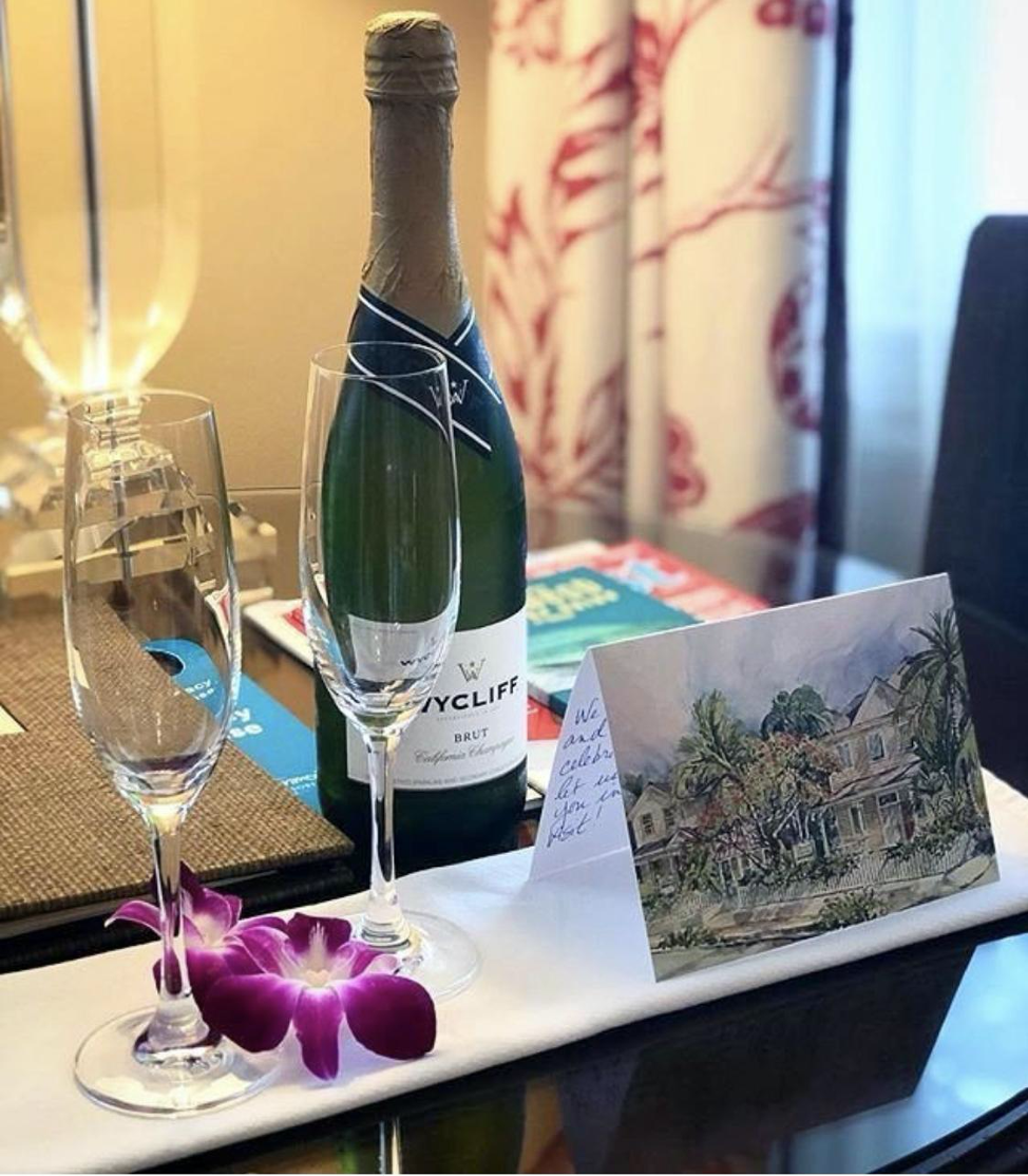 Bottle of sparkling with two glasses and card