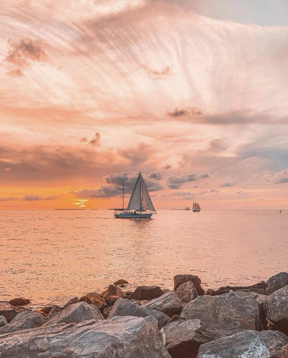 Ocean sunset with sailboat