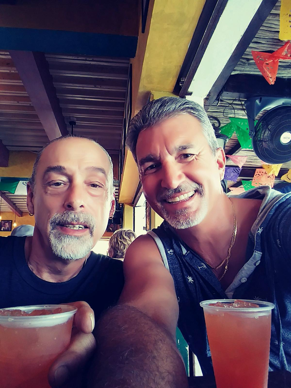 Todd Jones and male guest sharing a drink at Southernmost Beach Resort
