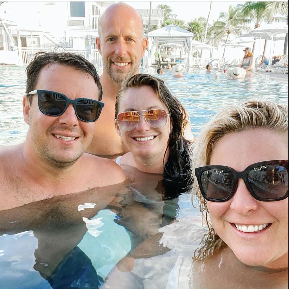 Group of friends selfie pool side.