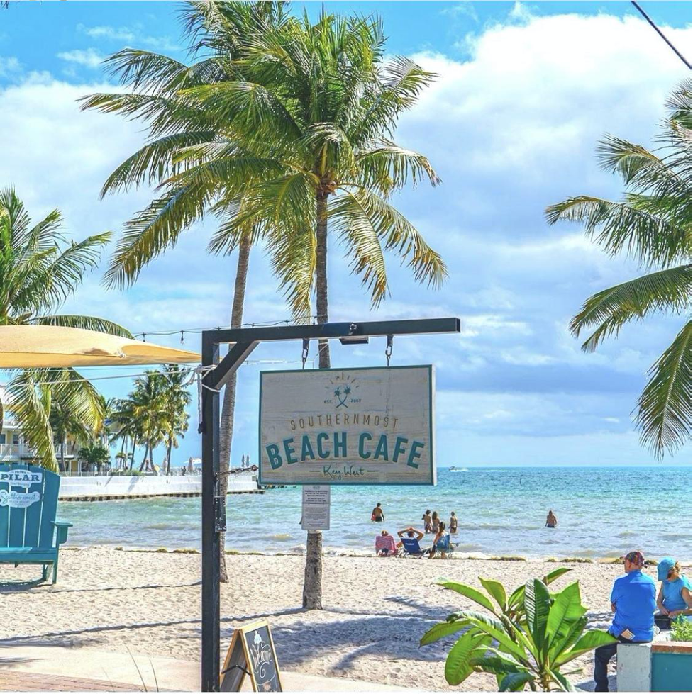 Southernmost Beach Cafe sign in-front of the beach.
