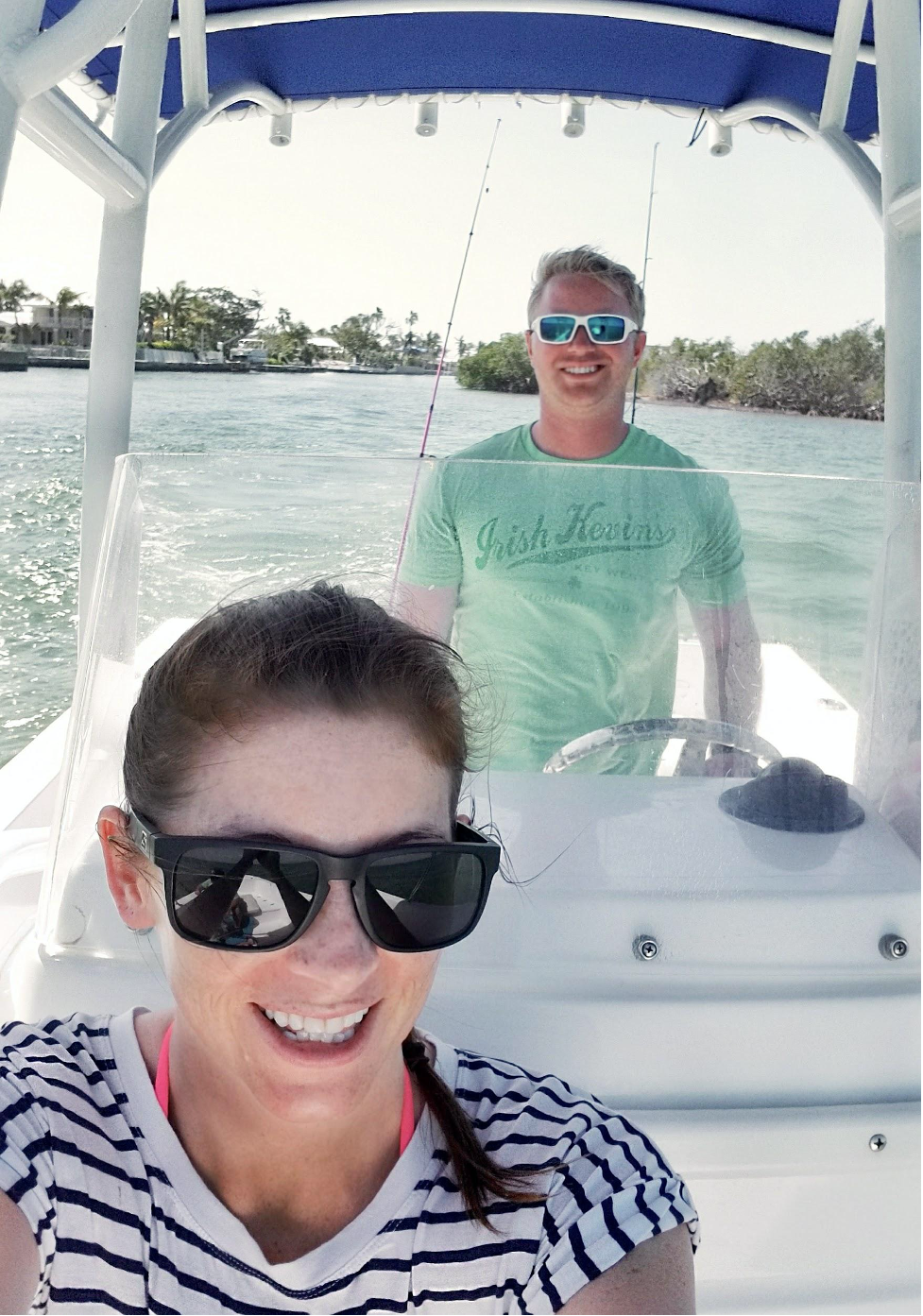 Boat selfie of man and woman.
