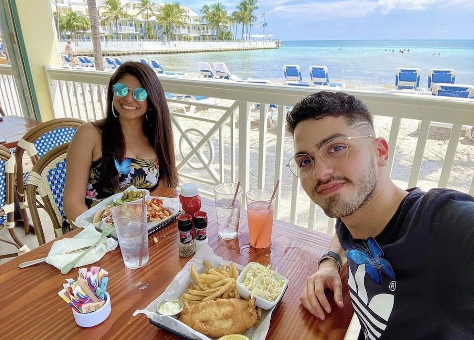 Couple enjoying the food and views from Southernmost Beach Cafe