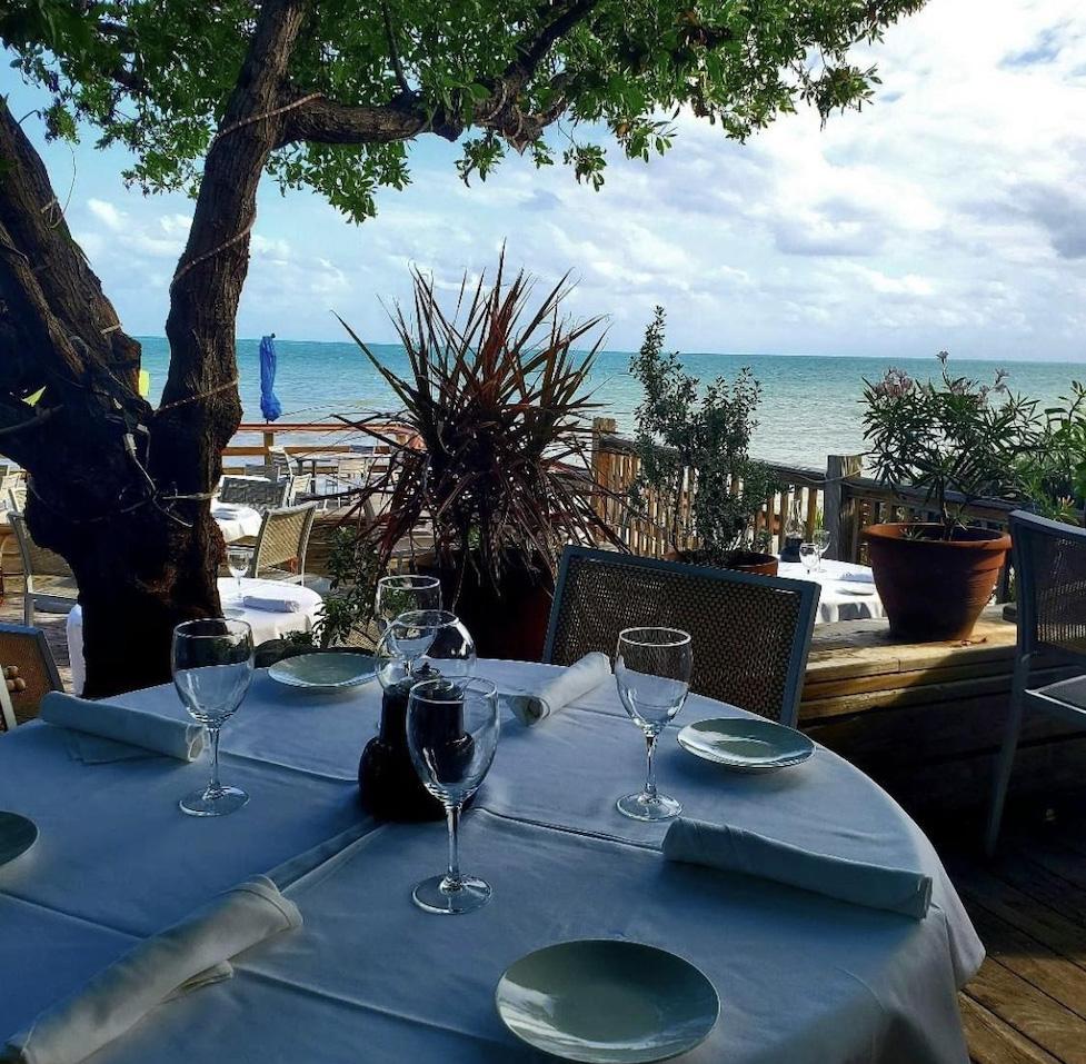 Beautifully set table overlooking a very blue Atlantic Ocean