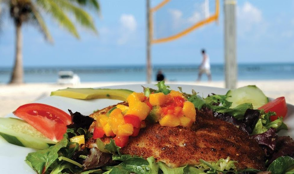 Colourful salad with tropical beach views