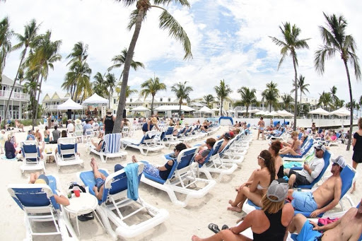 Many people on beach chairs enjoying a show