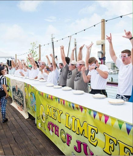 contestants cheering during World Key Lime Pie Eating Championship