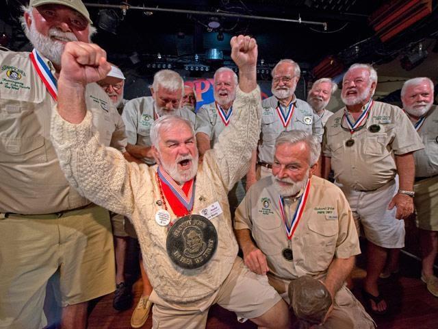Group of men in khakis celebrating Hemingway Days