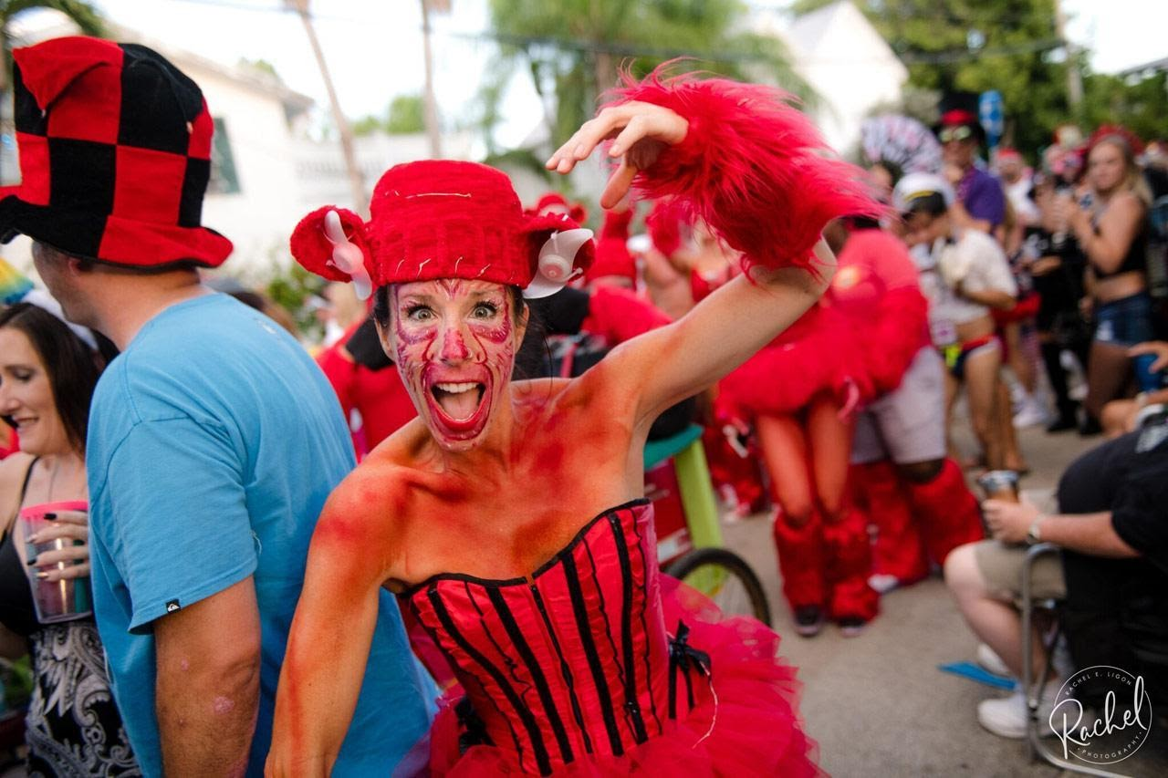 Woman wearing red costume during Fantasy Fest