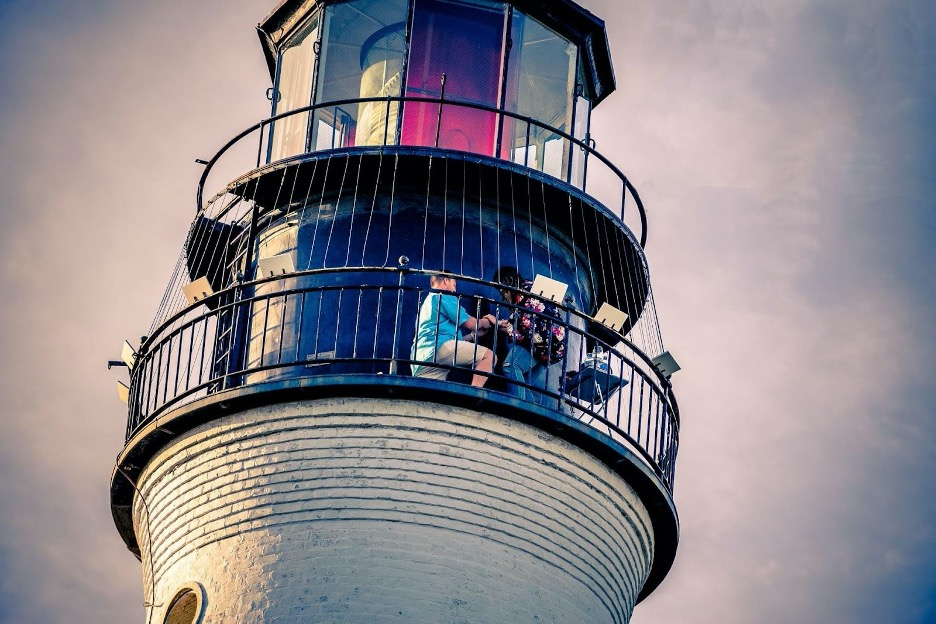 people on a lighthouse