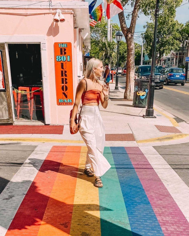 woman walking on a rainbow sidewalk